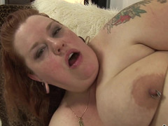 A fat redhead is getting a thick cock in her meaty pussy lips