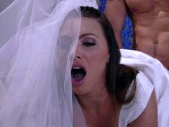 A sexy blonde in a wedding dress is getting penetrated by a fella