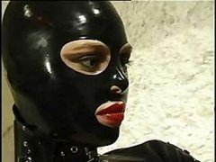 Hot cat female in leather suit does anything she wants to her aroused slave