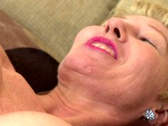 A hot granny is by herself, playing with her sensitive pussy