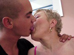 A fat granny is getting fucked in this nasty scene with a young dude