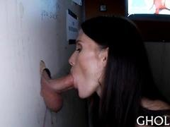Brunette giving head down gloryhole dick before taking it from behind