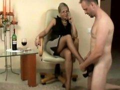Sexy German Milf give footjob