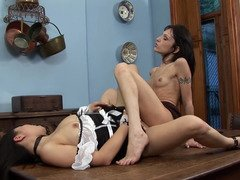 A duo sweet sluts are seducing one another on the table with dongs