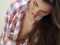A kitten that has her shirt and furthermore jeans on gets nude to show off