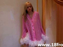 Pink small teenager stripping naked