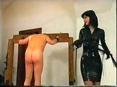 Man is kilted up and furthermore whipped as his latex clad dom abuses him