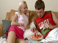 Young-looking blonde makes love her boyfriend in bed