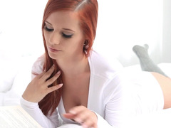 A redhead slowly takes off her clothes and moreover she touches her cunt