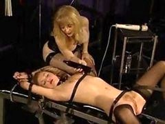 Stockinged blondie getting drilled by a huge having an intercourse machine