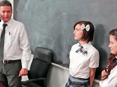 A duo girls are in a threesome in the classroom