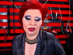 Erotically attractive Red Head Dom Milf Smoking On Cam In Boots