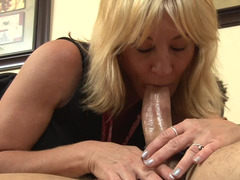 A mature babe is doing anal with a young man on the sofa