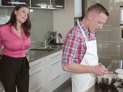Two girls are in the kitchen, pleasing a guy in a hot threesome