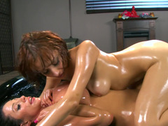 Two ladies are fucking each other in some oil in this hot scene