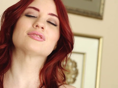 Solo redhead Jessica Ryan puts on an erotic show
