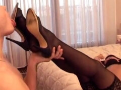 Smoking mistress gets pussy worshiped by her foot slave