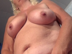 Blonde mature slut pleasing herself