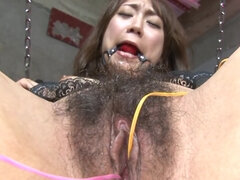 Oriental girl gets vibrators in muff and big one on clitoris