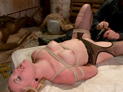 MILF lady is tied up and tormented by a masked man