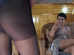 Brunette MILF lesbians in pantyhose petting and playing