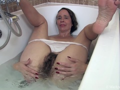 Josie takes a sexy wet bath and soaps up her body
