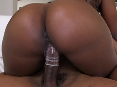Ebony chick with a giant ass is riding a bulky black cock here