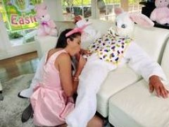 Smoking hot looking brunette is tempted to lay in a bed with her uncle in a rabbit costume