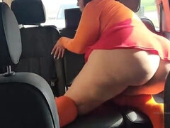 Meaty booty honey is stroking on the back seat of the truck, with a good-sized fake penis