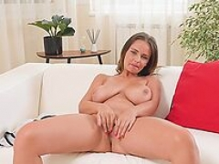 Beauty fondles her sizeable breasts and also fingers her dripping wet vagina