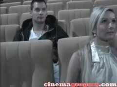 Perverted blonde likes her boobs touched in the cinema