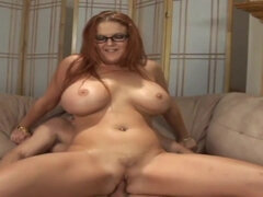 Redhead mommy with big boobs gives a head in glasses and rides big cock