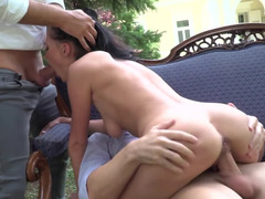 Comfortable sofa is outdoors for brunette who loves threesomes