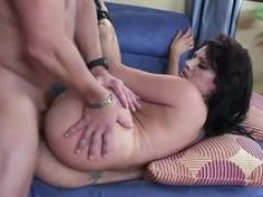 Tattooed gal has fun with a large penis
