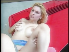 Excited blond gal gets a ,ride, in a ferrari