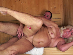 A plump aged kitten is fucked in the sauna by a big young stallion