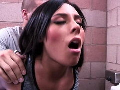 Dark haired stunner gets nailed in the public toilet