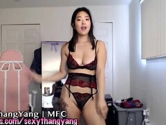Flexible Asian with big tits exercises and does handstand on webcam