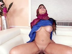 A bigtitted female is covering her head with a scarf while fucking