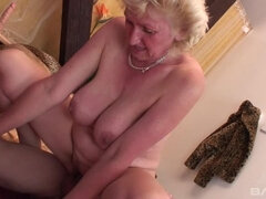 Naughty granny sucks a dildo while getting fucked from behind