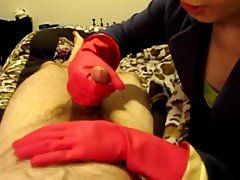 Sexy Oriental in Pink Rubber Gloves Handjob