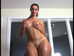 French BBWS Rosee Divine pops her oiled rear.