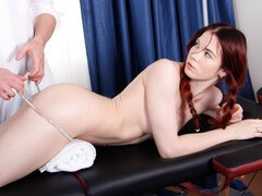 Ginger hottie gets a fuck on massage table