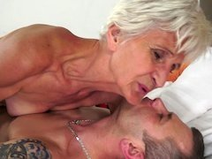 A nasty old short haired granny is giving bj a sizeable hard pecker