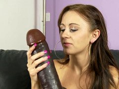 A brunette that loves to play with toys is riding a vibrator
