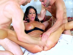 Reagan Foxx gets her cunt roughly fingered while she is stroking two cocks
