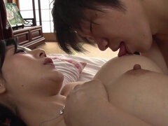 Japanese babe with big fake tits seducing a shy guy
