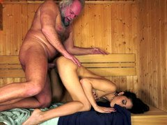 A brunette that loves old flag pole is getting penetrated in the sauna