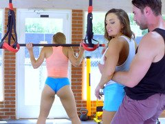 Two glamorous sportswomen perform threesome in the gym