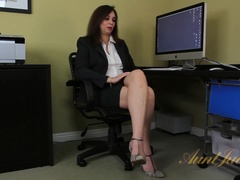 Milf Alesia Pleasure uses a toy in the office.